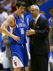 Roy Williams, during his Kansas coaching days, with