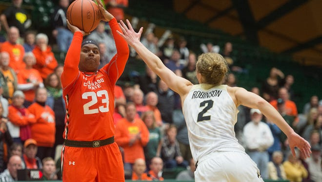 CSU guard Grace Colaivalu shoots for a final three point attempt at the buzzer during a game at Moby Arena on Wednesday, December 6, 2017.