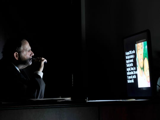 Judge Dee David Gay watches an 11-minute video produced