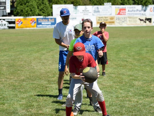 Campers participate in an agility drill at the Staunton