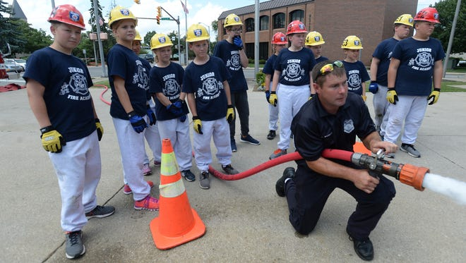 Participants of the Junior Fire Academy learn the parts of an obstacle course Friday, July 15, 2016, before graduating the program at Richmond Fire Department Station 1 on. S. A Street.