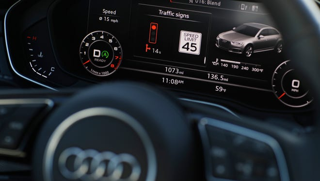 The dashboard of an Audi A4 is seen during a demonstration of Audi's vehicle-to-infrastructure technology Tuesday, Dec. 6, 2016, in Las Vegas.