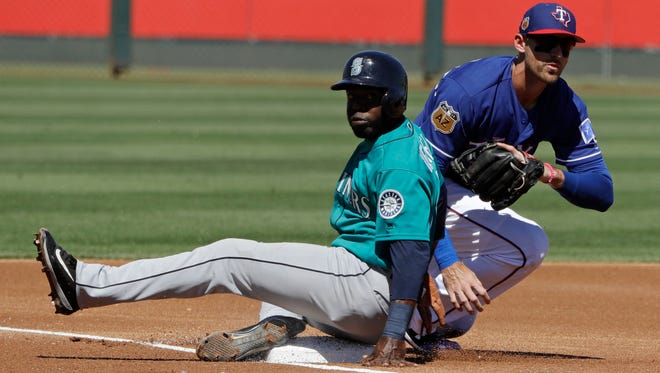 The Mariners' Guillermo Heredia slides safely into third base during a spring training game against Texas. Heredia beat out Ben Gamel for the backup outfielder spot.