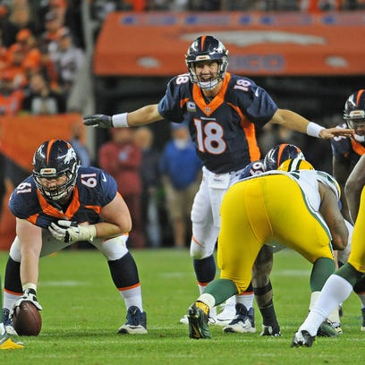Green Bay Packers inside linebacker Clay Matthews (52) lines up against Denver Broncos quarterback Peyton Manning (18) against the Denver Broncos at Sports Authority Field.