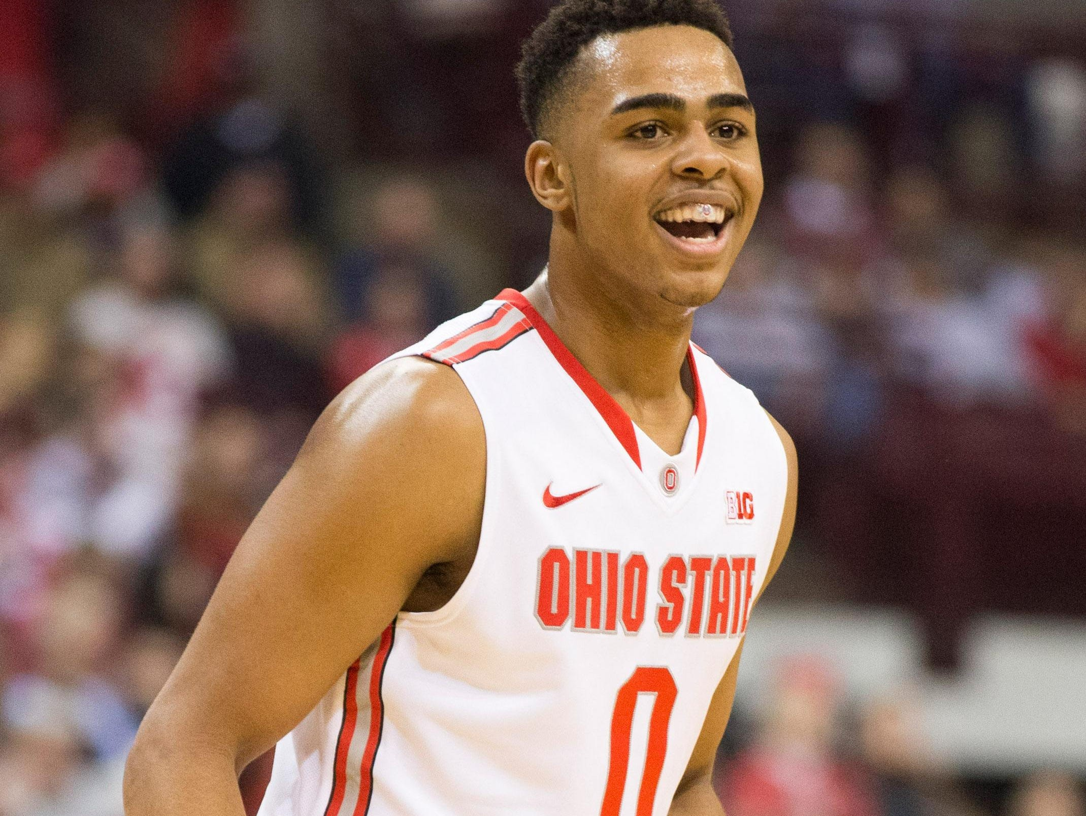 Ohio State Buckeyes guard D'Angelo Russell reacts after hitting a 3-point shot against the Marquette this past season. The Louisville native is set to become an early selection in Thursday's NBA draft.