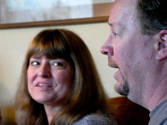 Kathy Cassity listens to her husband John talk about how he learned of her stroke one year ago.
