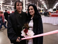 "David Waite, 39, and Olivia Vance, 26, both of White Lake, Mich., before their wedding Sunday, May 15, 2016, during the Motor City Comic Con 2016 at the Suburban Collection Showplace in Novi, Mich. Waite, who was dressed as Anakin Skywalker, and Vance, dressed as Padme Amidala, the mother of Luke Skywalker and Princess Leia, celebrated their wedding with a ""Star Wars"" theme."