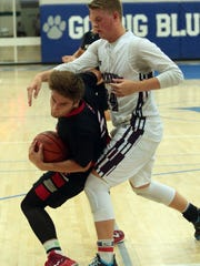 Palm Springs' David Pielaat, playing for the visiting team, spins around La Quinta's Jared Broadhead on his way to the basket during the Desert Valley All-Star Game at Cathedral City High on Friday.