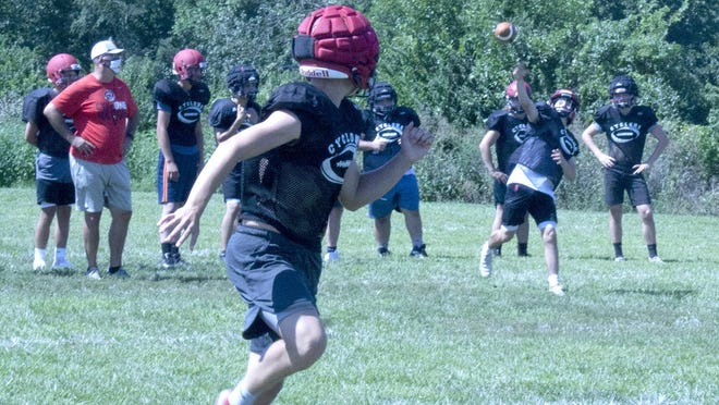 The Ottawa High School football team works on executing the passing game this past week during the first week of practice.