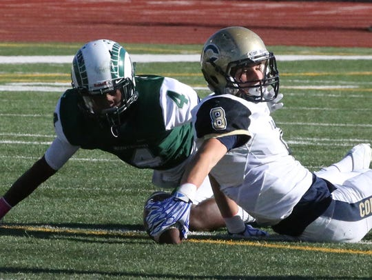 Coronado defensive end Carter McFadin, 8, comes up