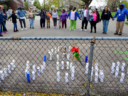 Family and friends gather at Girard Park to remember Oscar Cherry III