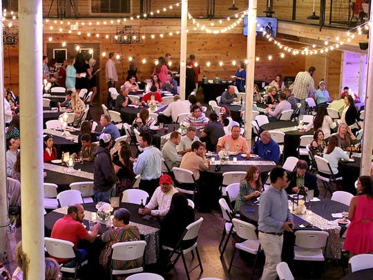 Hundreds of people eat and mingle during the 2017 Texoma's