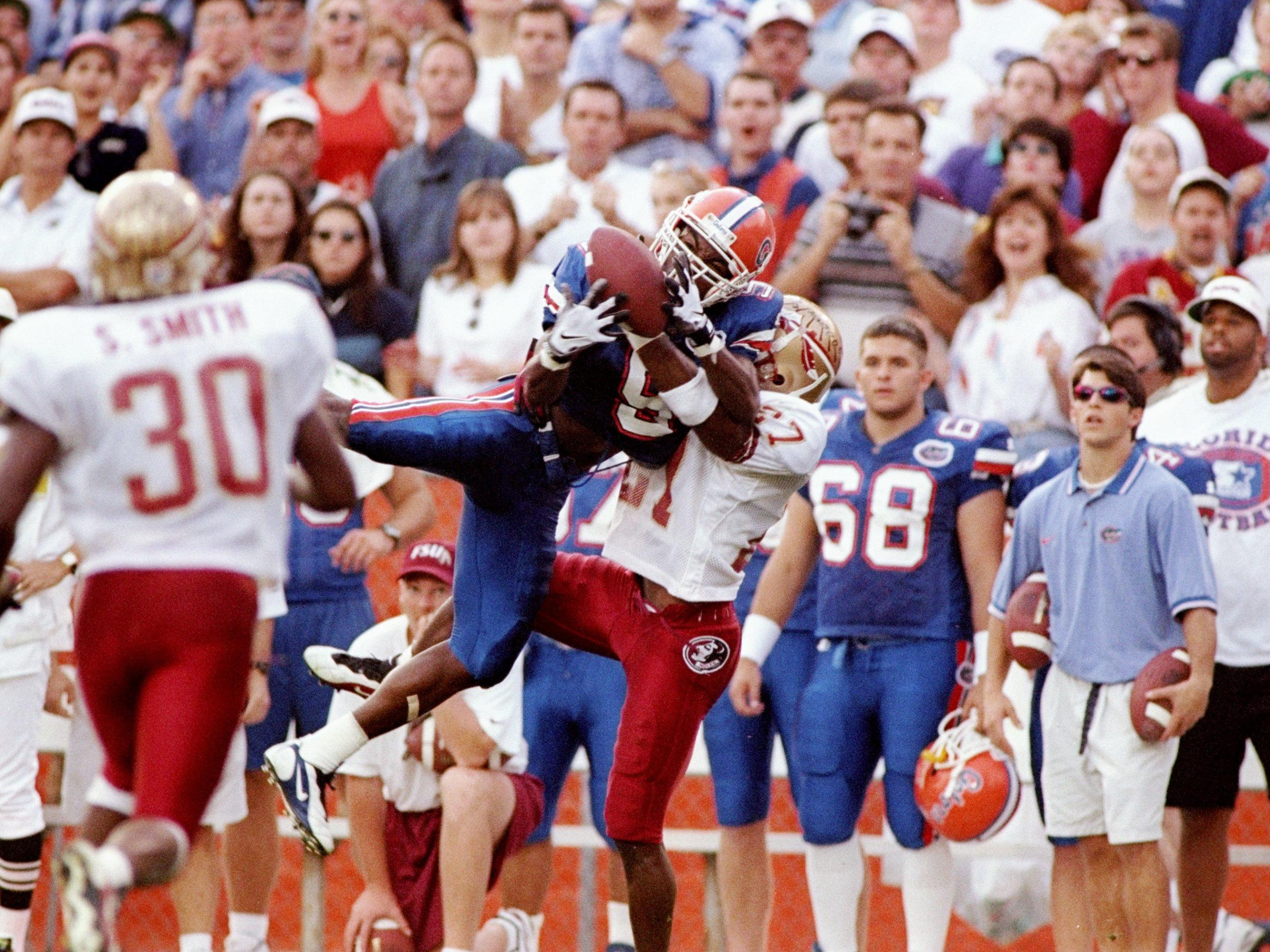 Florida wide receiver Jacquez Green makes a big catch against Florida State cornerback Tay Cody during a game in Gainesville in 1997. The Gators won the game 32-29.