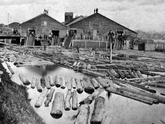 Much of Burlington's filled shoreline in the 19th century was devoted to the storage and milling of lumber - as shown in this photograph taken sometime between 1865 - 1870 by A.E. Mason.