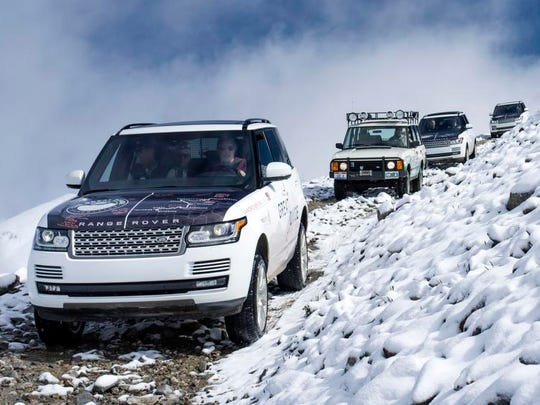 A new Range Rover leads a 25-year-old original model down from Mosquito Pass beside a steep 2,000-foot drop-off to the valley floor.