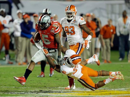 Ohio State quarterback Braxton Miller is tackled by Clemson safety Robert Smith during the 2014 Orange Bowl.