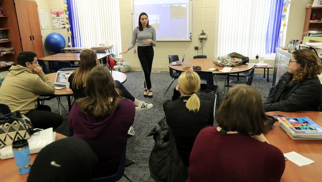 Bay Port junior Abbi Bender talks to other students Wednesday during a planning meeting for a March 14 school walkout at Bay Port High School in Suamico. The students are planning to walk out of class for 17 minutes on March 14, a month after a school shooting in which 17 students were killed in Parkland, Fla.