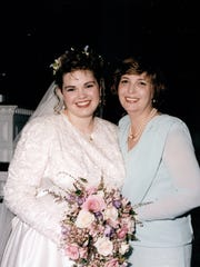 Christy Carlson, left, poses for a picture with her mom, Joanne Olejkowski, on her wedding day, March 13, 1993, at Hood College in Frederick, Md. Olejkowski said that the 24 inches of snow that blanketed the area made for a day her family would never forget.