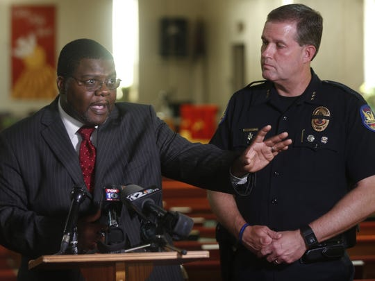 The Rev. Reginald D. Walton (left) and Mike Kurtenbach, Phoenix assistant police chief, speak during a press conference at Phillips Memorial CME Church on July 17, 2016, in Phoenix.