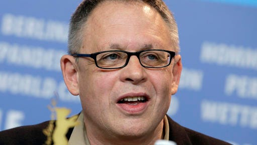 """FILE - In this Feb. 8, 2015, file photo, Director Bill Condon speaks during the photo call for the film Mr. Holmes at the 2015 Berlinale Film Festival in Berlin, Germany. Condon was only interested in turning Disney's animated classic """"Beauty and the Beast"""" into a live-action film if he could use Alan Menken's Oscar-winning score. It's fitting then that the twinkling instrumentals of Menken's prologue are the first thing you hear in the new trailer for the film released Monday, Nov. 14, 2016, by Disney."""