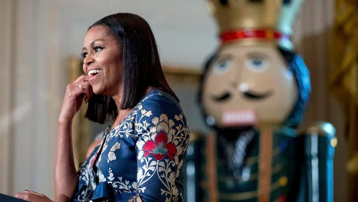 First lady Michelle Obama, pauses while speaking to military families in the East Room of the White House during a preview of the 2016 holiday decor, Tuesday, Nov. 29, 2016, in Washington.