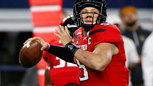FILE  - In this Nov. 25, 2016, file photo, Texas Tech quarterback Patrick Mahomes looks to throw against Baylor during the first half of an NCAA college football game in Arlington, Texas. Mahomes is bypassing his senior season for early entry in the NFL draft. Mahomes, the FBS leader this season with 5,052 yards passing, announced his decision during a campus news conference Tuesday, Jan. 3, 2017.