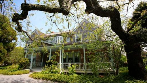 """FILE - In this May 15, 2009 photo, the """"Grey Gardens"""" house is shown in East Hampton, N.Y. Grey Gardens, the Hamptons home once owned by eccentric relatives of Jacqueline Kennedy Onassis, is for sale. It was featured in a documentary, HBO movie and Broadway musical. Newsday reports Wednesday, Feb. 8, 2017, it has been listed for nearly $20 million."""