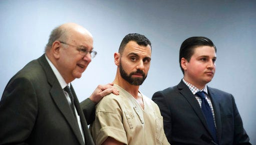 FILE - In this Monday, April 17, 2017, file photo, Richard Dabate, center, appears with attorneys Hubie Santos, left, and Trent LaLima, right, while being arraigned, in Rockville Superior Court in Vernon, Conn. Authorities said Dabate told them a masked man had entered their home Dec. 23, 2015, shot his wife and tied him up before he burned the intruder with a torch. But the New York Daily News reported the Connecticut State Police wrote in an arrest warrant that his wife's Fitbit was logging steps after the time Dabate told them she was killed.