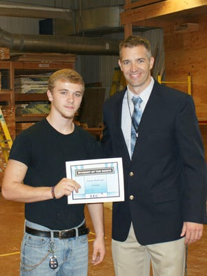 Cumberland County Technical Education Center Principal Greg McGraw presents Jacob Hickman (left) with a certificate in recognition of him being named the school's Student of the Month for September.