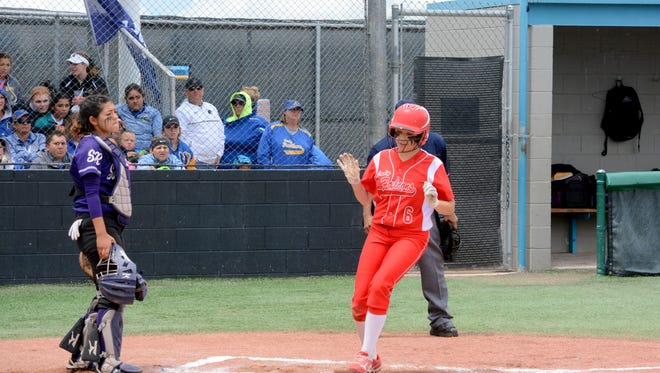 Loving's Anyssa Rodriguez scores a run against Santa Rosa in the 3A state quarterfinals Wednesday at Cleveland High.