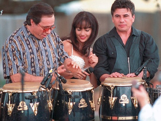 Caller-Times file Edward James Olmos (left) and actress Jennifer Lopez play around with a set of drums in between takes on the set of the Selena movie in Poteet, TX on Oct. 19, 1996.