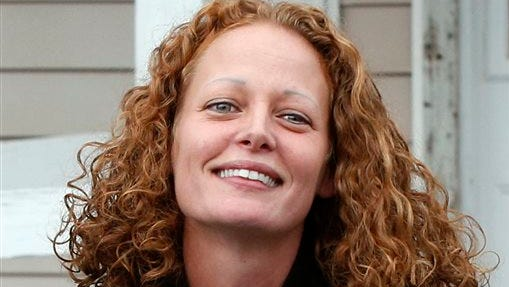 Kaci Hickox comes out of her house to speak to reporters, in Fort Kent, Maine. Hickox's plans for the end of the deadly disease's 21-day incubation period today include a dinner out with her boyfriend, but she told The Associated Press she's worried about what type of a reception she'll get after being hailed by some and vilified by others for battling state-ordered quarantines in New Jersey and Maine.