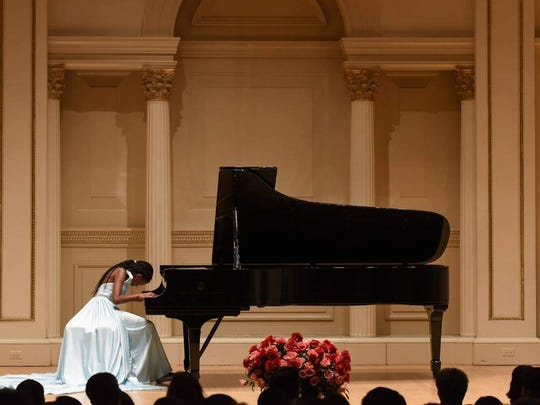 Asia Jaden Hickman, 13, plays piano. She will perform Friday in Jackson.