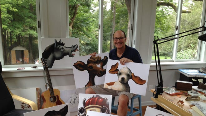 "Loren Long in his Cincinnati studio, surrounded by characters from his ""Otis"" series of children's books."