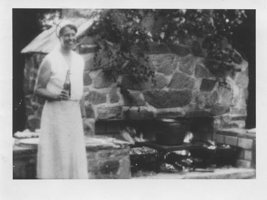 Eleanor Roosevelt stands in front of the now restored outdoor fireplace at Val-kill, where visitors are invited to roast their own hot dogs at the event on Saturday, Sept. 17.