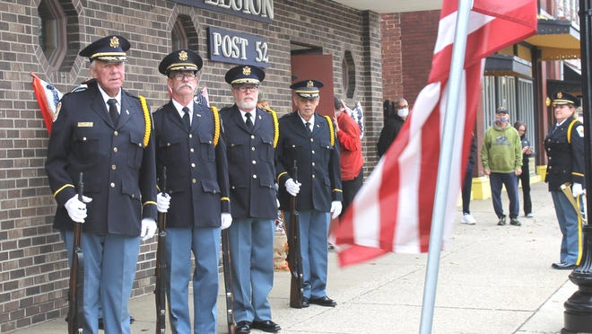 Coldwater American Legion honor guard salute the sacrifice of military personnel on Veterans Day.