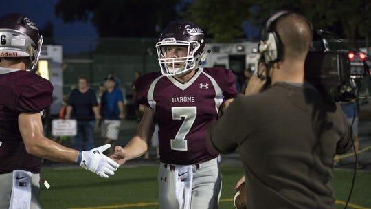 Manheim Central's Kody Kegarise is greeted by a teammate