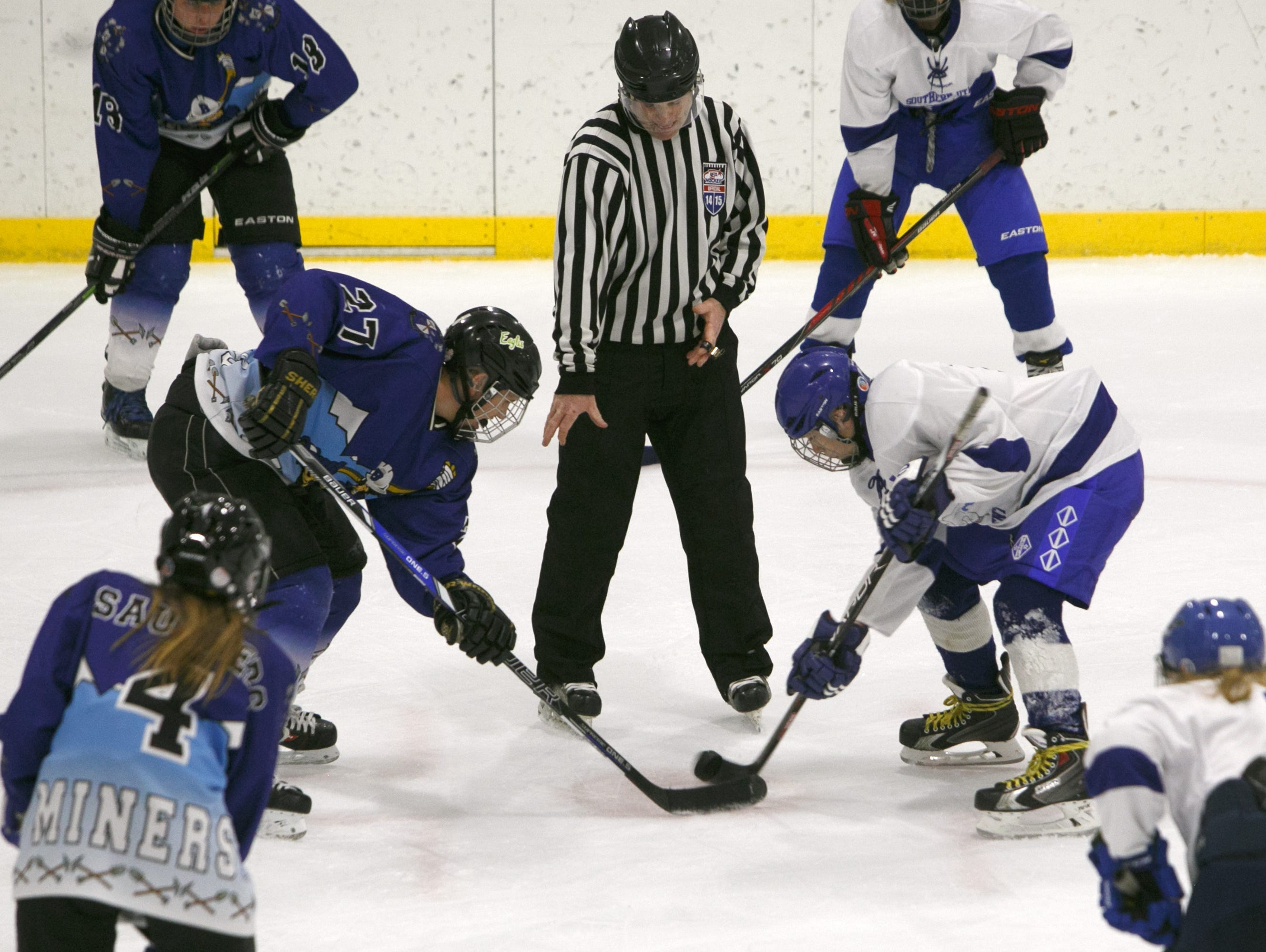 Southern Utah Independent players line up for a face-off with Bingham High School players during their game at the Peaks Ice Arena in Provo, Saturday, Nov. 14, 2015.