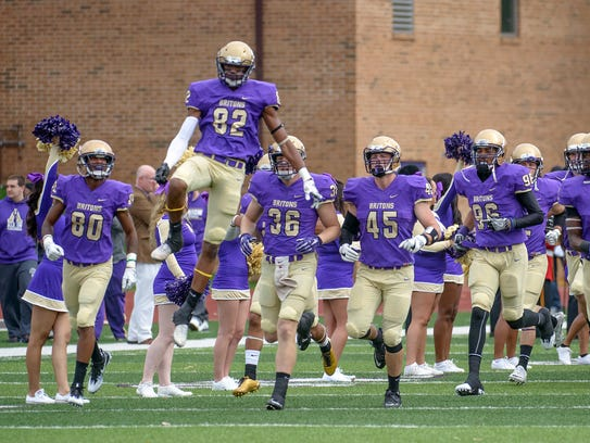 The Albion College football team takes the field on