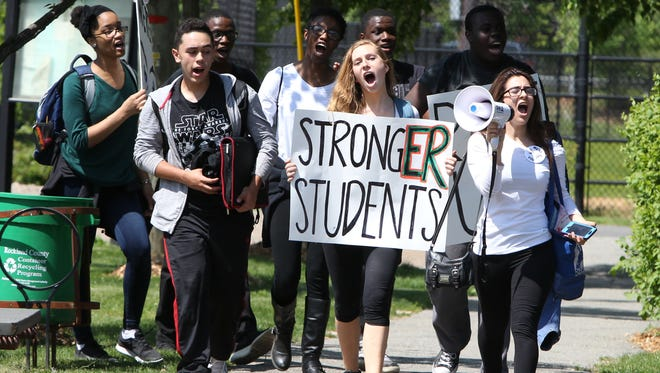 Students from Ramapo High School march to Memorial Park in Spring Valley May 20, 2016. They were protesting the school board and conditions in their school.