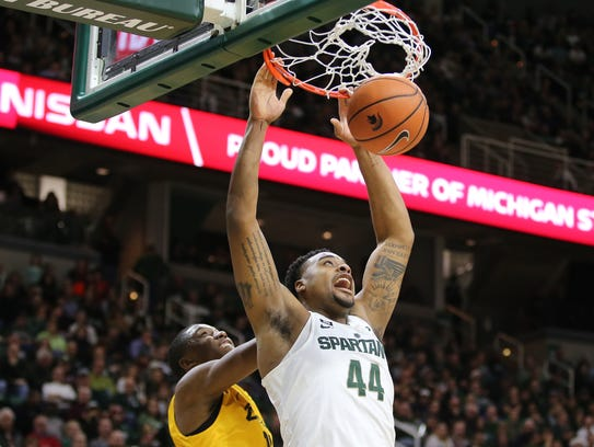 Michigan State's Nick Ward dunks the ball during the