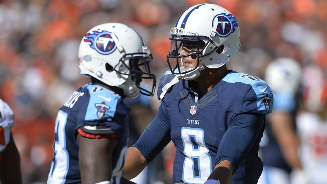 Titans quarterback Marcus Mariota  celebrates a 13-yard touchdown pass to wide receiver Dorial Green-Beckham, who caught his first TD pass of his career during the second half. Titans quarterback Marcus Mariota (8) celebrates a 13-yard touchdown pass to wide receiver Dorial Green-Beckham who caught his first TD pass of his career during the second half.