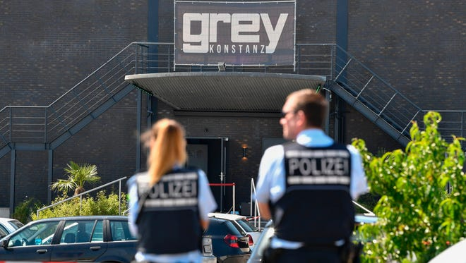 Police officers stand in front of the Grey nightclub in Konstanz , southern Germany, where a gunman opened fire on July 30, 2017.