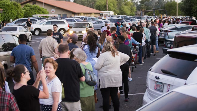 Voters waited in line at Pilgrim Evangelical Lutheran Church in Mesa. Some voters reported waiting in line for several hours.