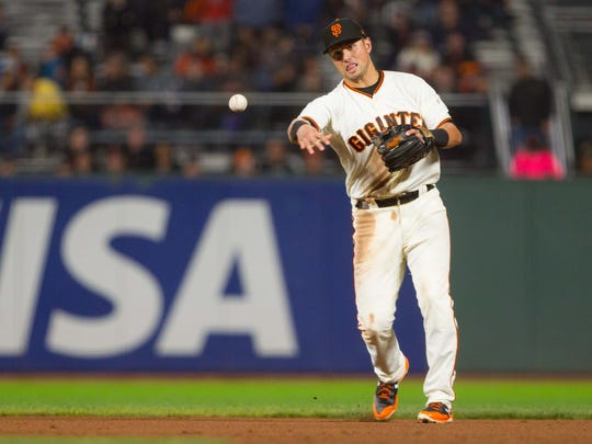 San Francisco Giants second baseman Joe Panik throws to first for an out against the Arizona Diamondbacks at AT&T Park on Sept. 16.