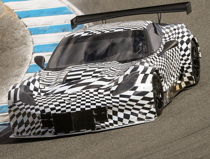 The Corvette Racing C7.R takes a turn at the Rolex Monterey Motorsports Reunion in Monterey, California.