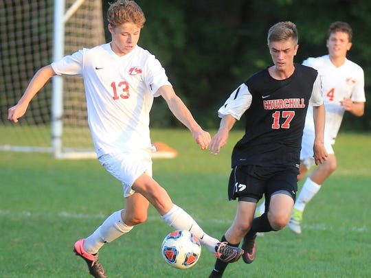 Churchill's Anthony Paul (17) marks Canton's Ryen O'Meara