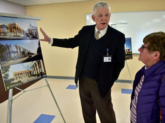 Project manager John Hart talks to Chambersburg resident Anna Shaffer about the Franklin County Court Facility Improvement Project during an open house on Thursday, January 11, 2018 at the county annex.