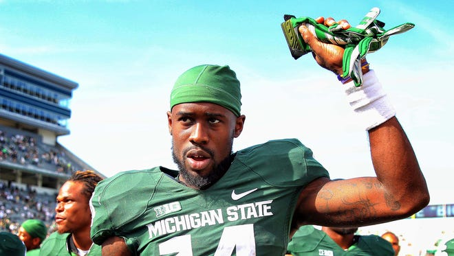 Michigan State Spartans wide receiver Tony Lippett  celebrates a win against the Wyoming Cowboys after a game at Spartan Stadium.