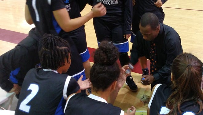 Cathedral City girls' basketball head coach Marques Hill designs a play during a timeout Thursday night at La Quinta.